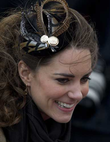 Kate Middleton, fiancee to Britain&#39;s Prince William, is seen as they visit Trearddur Bay Lifeboat Station on the island of Anglesey, Wales, Thursday, Feb. 24, 2011. Several hundred people cheered as Prince William and fiancee Kate Middleton made a rare public appearance Thursday to dedicate a new lifeboat. They plan to marry April 29 at Westminster Abbey.  <span class=meta>(&#40;AP Photo&#47;Jon Super&#41;)</span>